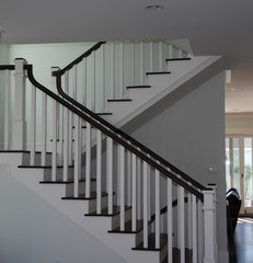 traditional staircase by Lane Design + Build