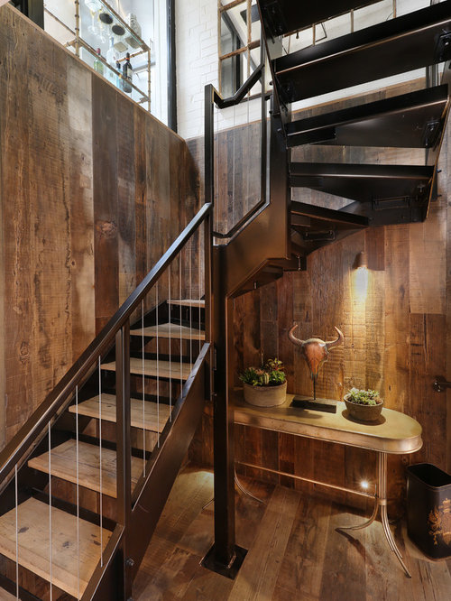 Example Of A Mountain Style Wooden Curved Open Staircase Design In London