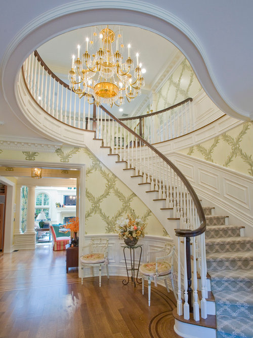 Inspiration For A Timeless Wooden Curved Staircase Remodel In New York