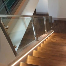 Contemporary Staircase by STYLE BATH ENCLOSURES