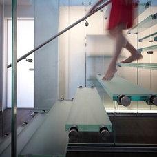 Modern Staircase by Thomas Roszak Architecture, LLC