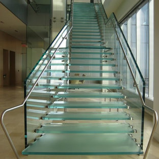 Huge minimalist glass straight open and glass railing staircase photo