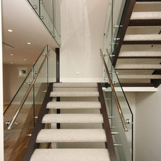 Contemporary Staircase by Ranger Homes Inc