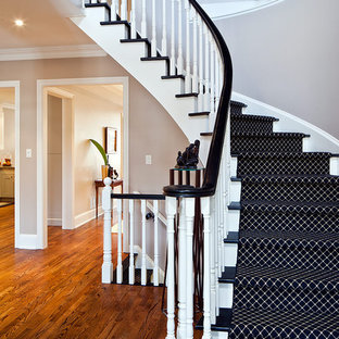 Example of a trendy curved staircase design in Toronto