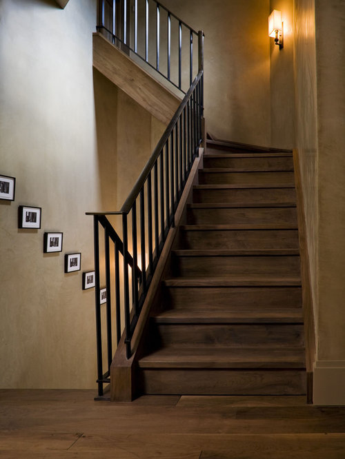 Trendy wooden metal railing staircase photo in New York