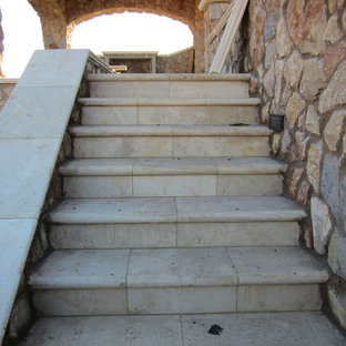 Design ideas for a medium sized mediterranean straight staircase in Phoenix with limestone treads and limestone risers.