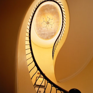 Example of a classic curved staircase design in Chicago