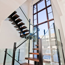 Contemporary Staircase by Norelco Cabinets Ltd