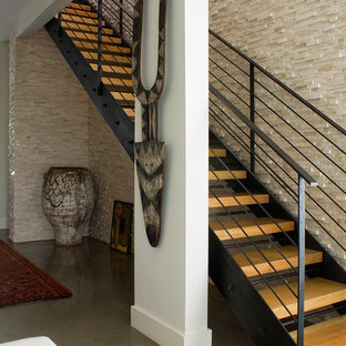 Island style wooden straight open and cable railing staircase photo in Orlando