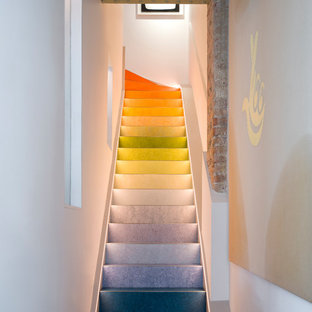 Inspiration for a medium sized eclectic staircase in London.