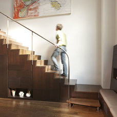 Contemporary Staircase by LMA GROUP INC.