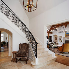 Traditional Staircase by OMNIA Group Architects