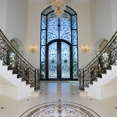 Mediterranean Staircase by Sweaney Custom Homes, Inc.