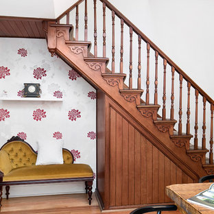 This is an example of a traditional wood straight staircase in Sydney with wood railing and wood risers.