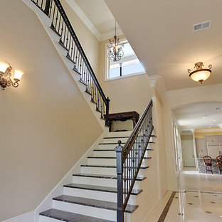 Inspiration for a mid-sized timeless painted u-shaped staircase remodel in New Orleans with tile risers
