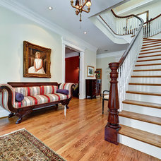 Traditional Staircase by Arlington Construction Management