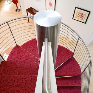 Ispirazione per una scala sospesa contemporanea di medie dimensioni con pedata in cemento e nessuna alzata
