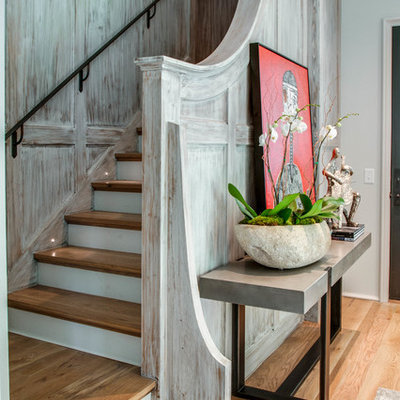 Staircase - eclectic wooden wood railing staircase idea in Nashville with painted risers