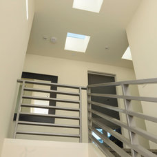Contemporary Staircase by Heydt Designs