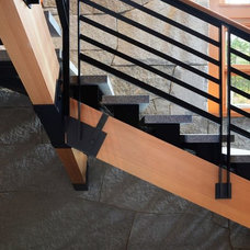 Modern Staircase by Sisler Builders, Inc.