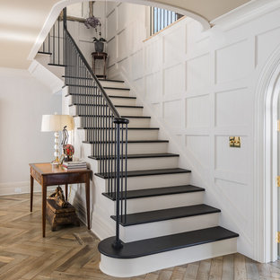 Elegant painted l-shaped staircase photo in New York with painted risers