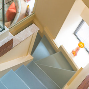 Small transitional painted u-shaped staircase photo in New York with painted risers
