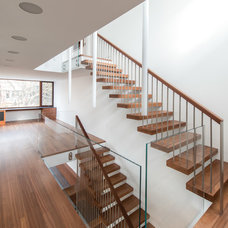 Contemporary Staircase by Altius Architecture, Inc.