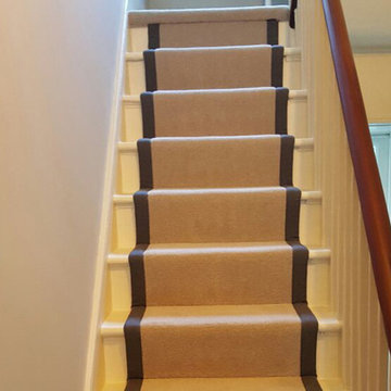 Grey Carpet to Stairs with Black Border as Carpet Runner