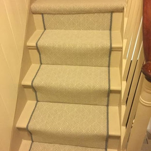 Staircase - contemporary carpeted u-shaped wood railing staircase idea in London with carpeted risers