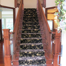 Traditional Staircase by Guinn Construction LLC