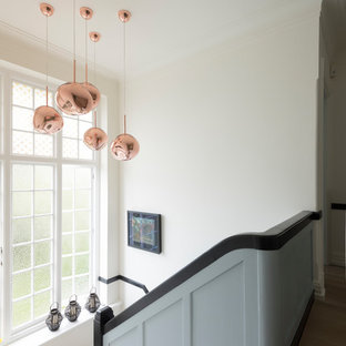Design ideas for a large classic carpeted wood railing staircase in London.