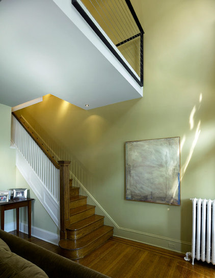 traditional staircase by KUBE architecture