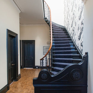 Photo of a bohemian wood curved staircase in Glasgow with wood risers.