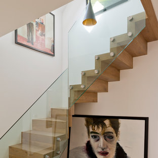 Medium sized contemporary wood l-shaped staircase in London with wood risers.