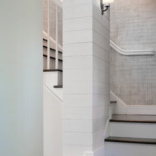 traditional staircase by Wettling Architects