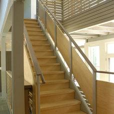 Farmhouse Staircase by John Hummel & Associates Custom Builders