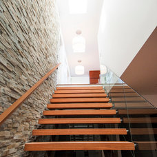 Contemporary Staircase by MKL Construction Corp.