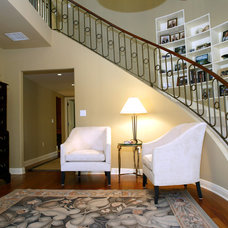 Traditional Staircase by Custom Design & Construction