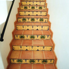 Eclectic Staircase by Howe Custom Home Builders