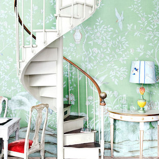 Design ideas for a small traditional wood spiral staircase in Other with painted wood risers.