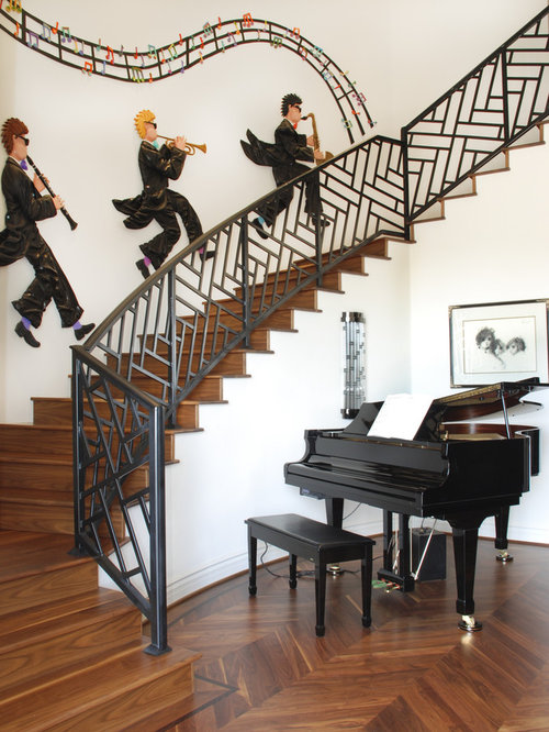 example of a trendy wooden curved staircase design in phoenix