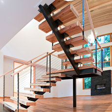 Contemporary Staircase by YS BUILT, LLC