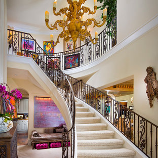 Inspiration for a huge mediterranean carpeted curved staircase remodel in Orange County with carpeted risers