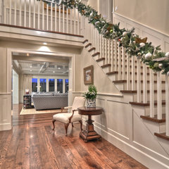 traditional staircase by Spinnaker Development