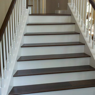 Inspiration for a large timeless wooden l-shaped staircase remodel in Tampa with painted risers