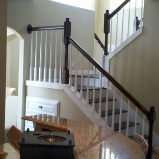 Inspiration for a large timeless wooden l-shaped staircase remodel in Orlando with painted risers