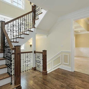 Inspiration for a timeless wooden u-shaped mixed material railing staircase remodel in Dallas with painted risers
