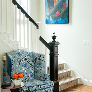 Staircase - beach style painted l-shaped staircase idea in Portland Maine with painted risers