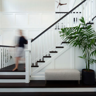Inspiration for a large beach style wood l-shaped staircase in Brisbane with painted wood risers and wood railing.