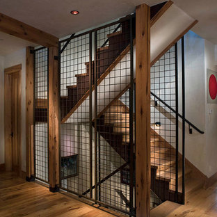 Inspiration for a large rustic wood l-shaped staircase in Denver with wood risers.